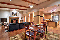 Open dining and living with maple wrapped columns