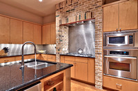 Kitchen with stainless steel appliances and commercial grade cooktop
